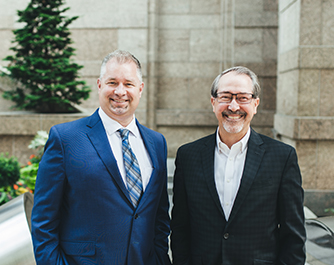 Two smiling Umpqua commercial bankers